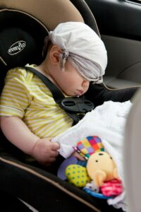 sleeping child on a car seat